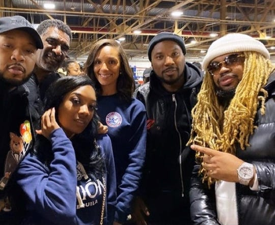 Councilwoman Mary Sheffield, center, with Dj Slick B, right, and others at a toy drive. The hip-hop artist was shot and killed by a robber, police said.