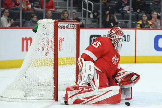 Red Wings goaltender Jonathan Bernier makes a save during the third period of the Wings' 3-1 win over the Bruins on Sunday, Feb. 9, 2020, at Little Caesars Arena.