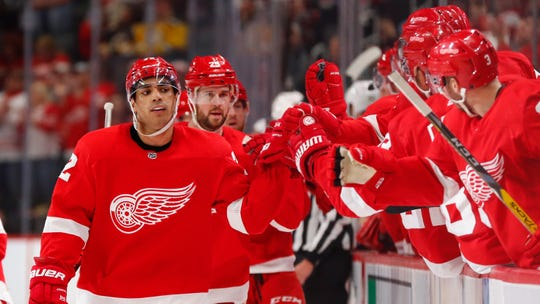 Red Wings left wing Andreas Athanasiou celebrates scoring in the third period of the Wings' 3-1 win over the Bruins on Sunday, Feb. 9, 2020, at Little Caesars Arena.