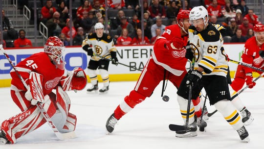 Bruins left wing Brad Marchand tries to redirect a shot as Red Wings goaltender Jonathan Bernier defends in the first period on Sunday, Feb. 9, 2020, at Little Caesars Arena.