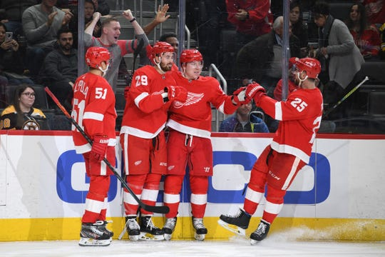 Red Wings left wing Brendan Perlini celebrates his goal with teammates during the second period on Sunday, Feb. 9, 2020, at Little Caesars Arena.