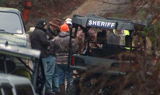 In this photo provided by WSB-TV, authorities work the scene of a jet crash in a remote area in Gordon County, Ga., Saturday, Feb. 8, 2020.