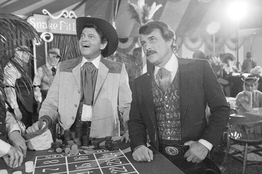 "FILE - In this June 4, 1980, file photo, actors Ross Martin, left, and Robert Conrad, right, are shown while filming a scene of the motion picture ""More Wild, Wild West,"" in Los Angeles."