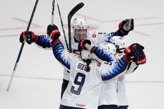 U.S. players celebrate Megan Bozek's overtime goal against Canada in a Rivalry Series game on Saturday in Anaheim, Calif.