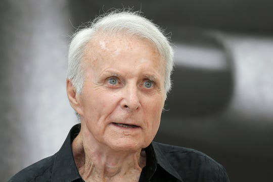 "FILE - In this June 12, 2013, file photo, actor Robert Conrad of TV series ""The Wild Wild West"" poses for photographers during the 2013 Monte Carlo Television Festival, in Monaco."