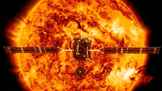 This illustration made available by NASA depicts the Solar Orbiter satellite in front of the sun.