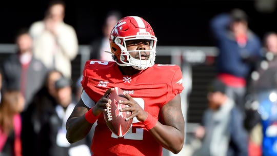 DC Defenders quarterback Cardale Jones (12) looks to throw a pass against the Seattle Dragons during the first half Saturday in Washington.