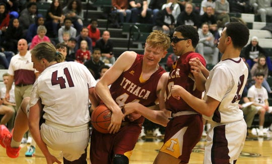 Elmira's Trey Hawken (41) and Devin Dennard (32) battle Ithaca's Keif Timmins (44) and Travion Brooks for the ball during the Little Red's 67-56 win in boys basketball Feb. 8, 2020 at Elmira High School.