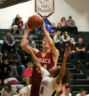 Keif Timmins puts up a shot for Ithaca in a 67-56 win over Elmira in boys basketball Feb. 8, 2020 at Elmira High School.