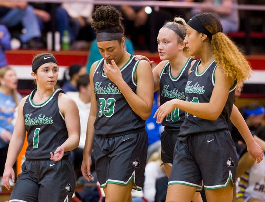 North Lady Huskies gather around North's Kaliah Neighbors (33) after she is fouled during the IHSAA Class 4A girls basketball sectional championship game against the Castle Lady Knights at Harrison High School Saturday evening, Feb. 8, 2020.