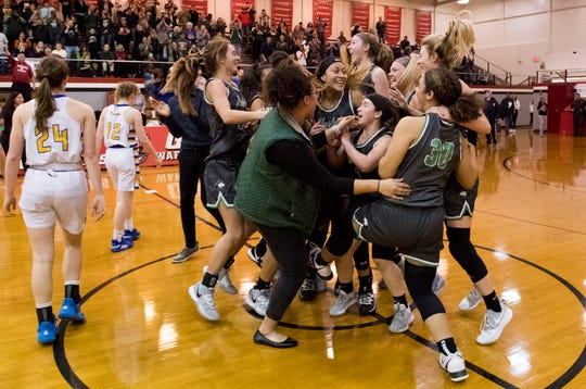 North celebrates its Class 4A sectional championship after defeating Castle 56-44 on Saturday night.