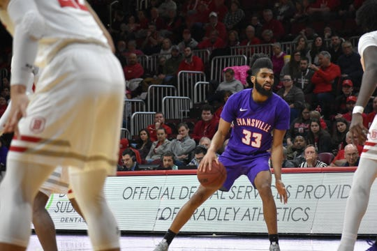KJ Riley dribbles during Evansville's game at Bradley on Sunday in Peoria, Illinois.