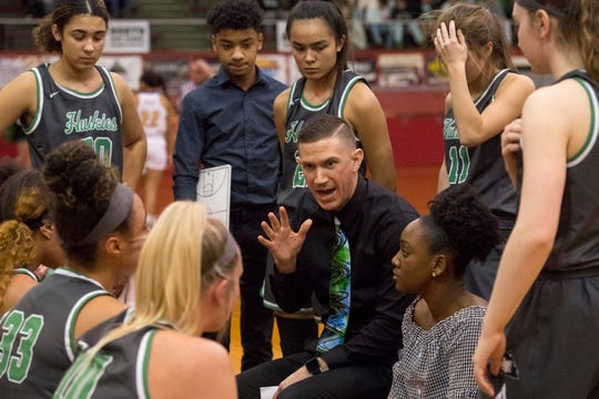 North Head Coach Tyler Choate gives direction during a timeout in the IHSAA Class 4A girls basketball sectional championship game against the Castle Lady Knights at Harrison High School Saturday evening, Feb. 8, 2020.