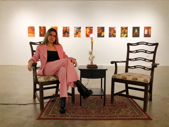 Artist Claudia Guerra sits at the center of her first solo exhibition.