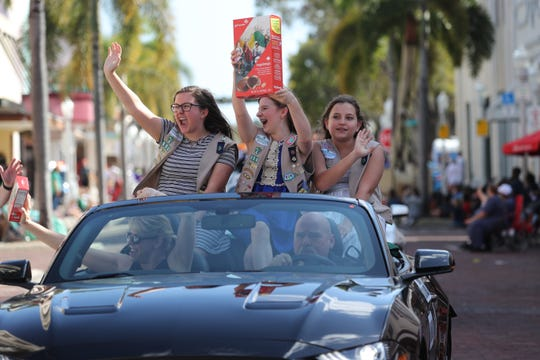 Olivia Trader holds up her jumbo-sized Tagalongs box during Sunday's Edison Festival of Light Junior Parade.