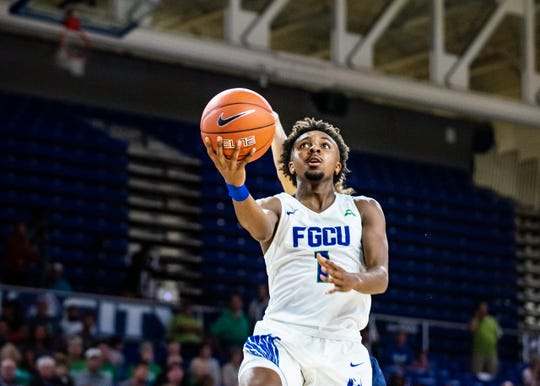 FGCU guard Zach Scott goes in for a lay-up against North Florida on Feb. 8, 2020. The Ospreys defeated the Eagles, 69-60.