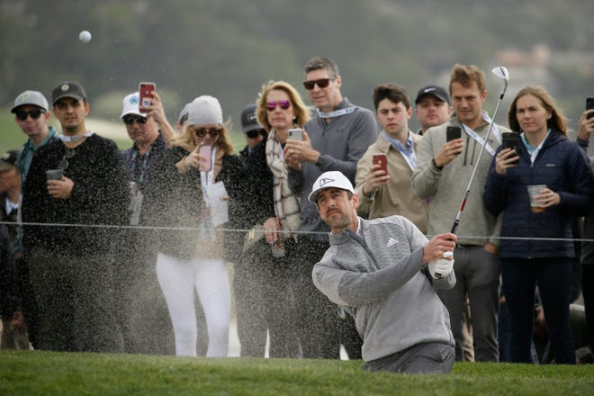 Aaron Rodgers hits out of a bunker onto the sixth green of the Pebble Beach Golf Links during the third round of the AT&T Pebble Beach National Pro-Am golf tournament Saturday, Feb. 8, 2020, in Pebble Beach, Calif.