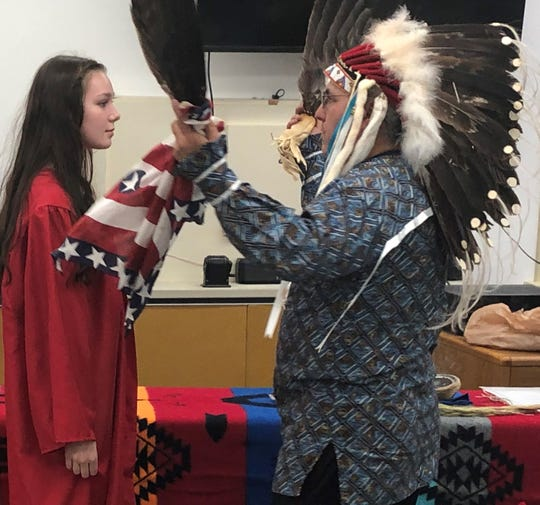 Three Native American students received an eagle feather at the Paris Gibson Education Center winter graduation ceremony.