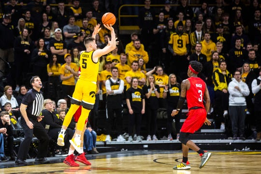 Iowa guard CJ Fredrick (5) makes a 3-point basket at the end of the first half during a NCAA Big Ten Conference men's basketball game against Nebraska, Saturday, Feb. 8, 2020, at Carver-Hawkeye Arena in Iowa City, Iowa.