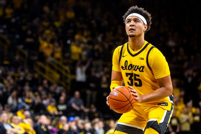 Iowa forward Cordell Pemsl (35) shoots a free throw during a NCAA Big Ten Conference men's basketball game, Saturday, Feb. 8, 2020, at Carver-Hawkeye Arena in Iowa City, Iowa.