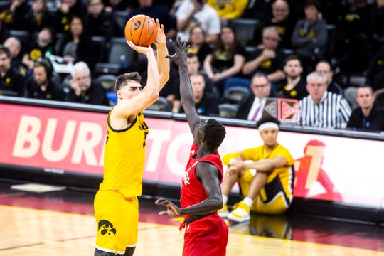 Star center Luka Garza and the Iowa Hawkeyes are squarely in the NCAA Tournament picture despite a couple of lopsided road losses. They get a chance to bolster their case Sunday at Minnesota.