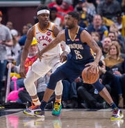 New Orleans Pelicans guard E'Twaun Moore (55) works the ball inside against the defense of Indiana Pacers guard Aaron Holiday (3) during the first half of an NBA basketball game, Saturday, Feb. 8, 2020, in Indianapolis at Bankers Life Fieldhouse.