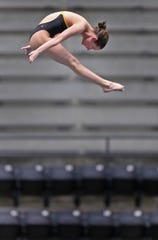 Plainfield High School diver Daryn Wright dives off the 10m platform during practice at the IUPUI Natatorium, Thursday, Feb. 6 2020.