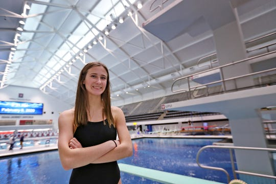 Plainfield High School diver Daryn Wright smiles on a diving board at the IUPUI Natatorium, Thursday, Feb. 6 2020.