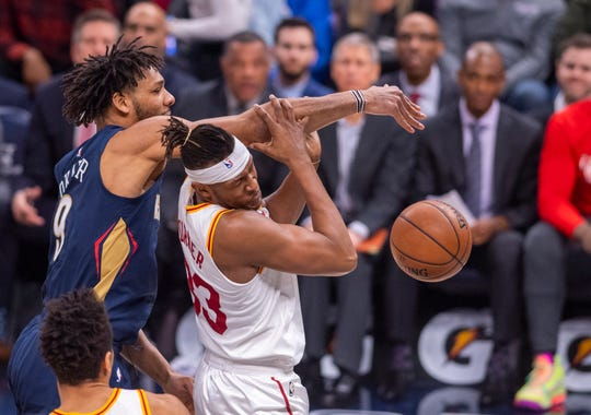 Indiana Pacers center Myles Turner (33) makes contact with New Orleans Pelicans center Jahlil Okafor (9) as the two battle for a rebound during the first half of an NBA basketball game, Saturday, Feb. 8, 2020, in Indianapolis at Bankers Life Fieldhouse.