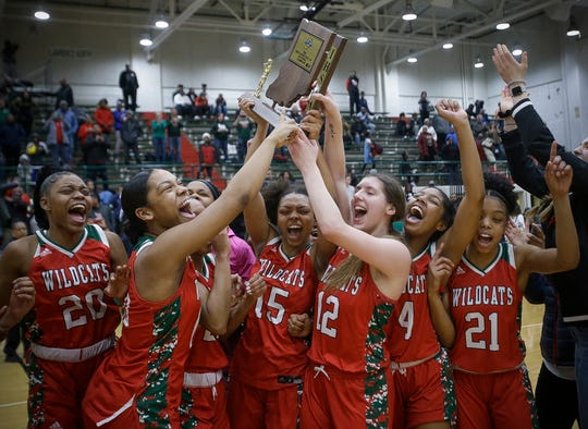 Lawrence North players celebrate their sectional championship win over North Central.