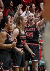 Fishers Tigers Lydia Stullken (32) and her teammates celebrate a three against the Hamilton Southeastern Royals in the first half of the Westfield sectional final on Saturday, Feb. 8, 2020. The Fishers Tigers defeated the Hamilton Southeastern Royals 50-42.
