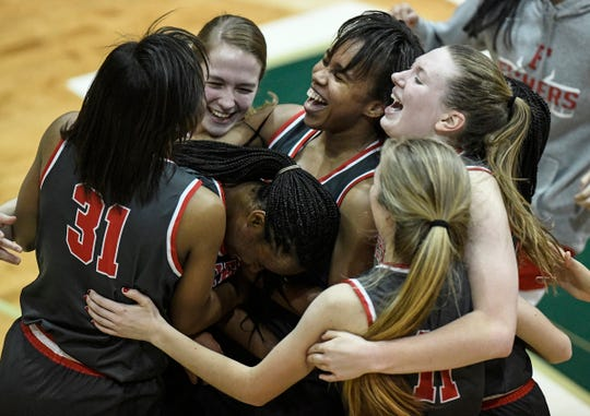 The Fishers Tigers celebrate at the buzzer after defeating the Hamilton Southeastern Royals in the Westfield sectional final on Saturday, Feb. 8, 2020. The Fishers Tigers defeated the Hamilton Southeastern Royals 50-42.