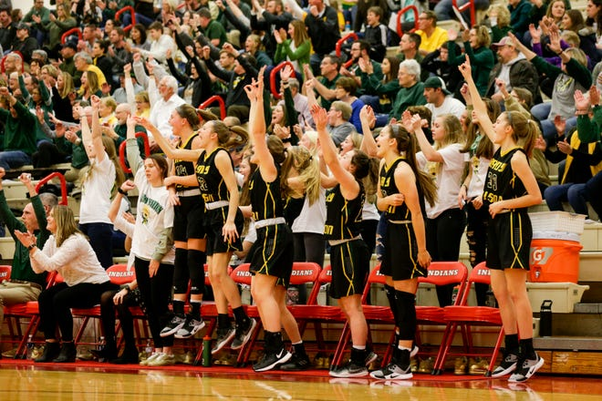 The Benton Central bench reacts during the second quarter of an IHSAA girls sectional championship basketball game, Saturday, Feb. 8, 2020 in Monticello.