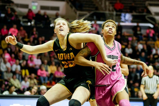 Iowa center Monika Czinano (25) boxes out Purdue forward Ae'Rianna Harris (32) during the fourth quarter of a NCAA women's basketball game, Sunday, Feb. 9, 2020 at Mackey Arena in West Lafayette.