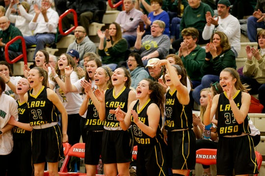 The Benton Central bench reacts during the third quarter of an IHSAA girls sectional championship basketball game, Saturday, Feb. 8, 2020 in Monticello.