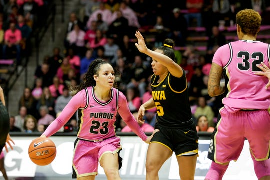 Purdue guard Kayana Traylor (23) dribbles against Iowa guard Alexis Sevillian (5) during the second quarter of a NCAA women's basketball game, Sunday, Feb. 9, 2020 at Mackey Arena in West Lafayette.