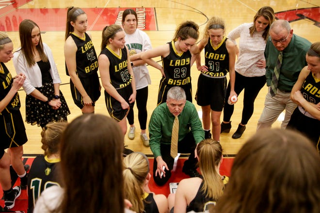 Benton Central's David Baxter talks to his team during a timeout in the third quarter of an IHSAA girls sectional championship basketball game, Saturday, Feb. 8, 2020 in Monticello.