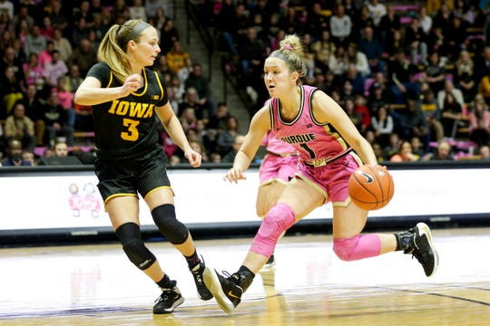 Purdue guard Karissa McLaughlin (1) drives against Iowa guard Makenzie Meyer (3) during the third quarter of a NCAA women's basketball game, Sunday, Feb. 9, 2020 at Mackey Arena in West Lafayette.