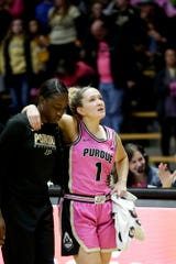 Purdue guard Karissa McLaughlin (1) is supported by a teammate after an injury on the court, Sunday, Feb. 9, 2020 at Mackey Arena in West Lafayette.