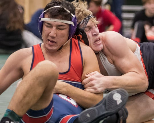 Brighton's Greyson Stevens (right) beat Westland John Glenn's Sadiq Sheiknmeeri in the 189-pound final at the KLAA individual wrestling tournament on Saturday, Feb. 8, 2020 in Howell.