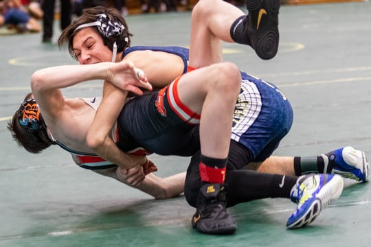 Hartland's Wyatt Nault (top) beat Brighton's Aiden Smith, 12-9, in the 119-pound championship match at the KLAA individual tournament on Saturday, Feb. 8, 2020 in Howell.