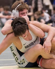 Hartland's Avery Dickerson controls Brighton's Dane Donabedian on his way to a championship at 171 pound in the KLAA individual wrestling tournament on Saturday, Feb. 8, 2020 in Howell.