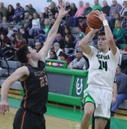 Clear Fork's Brennan South hits a shot at the buzzer during a loss to Shelby on Saturday night.