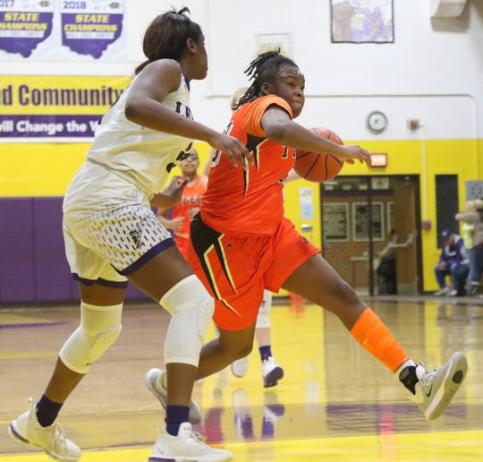 Mansfield Senior's JayJahnae Feagin drives to the basket during the Lady Tygers' loss to Lexington on Saturday afternoon.