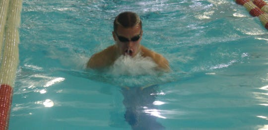 Lexington's Ben Starling shows his winning form in the 100 breaststroke.