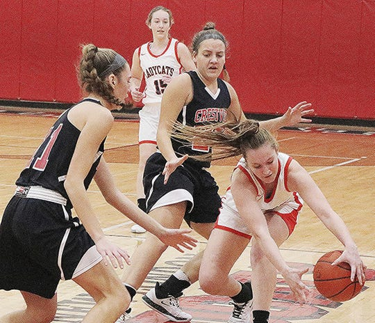 New London High School Lexi Duggar almost loses control of the basketball during girl's basketball as Crestview High School Mary Leeper (20) and Kathleen Leeper try to catch the ball during the action Saturday, February 8, 2020.