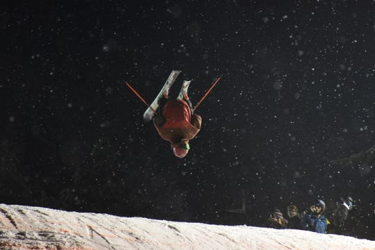 A competitor attempts a double flip Saturday during the Big Air Competition at Snow Trails.