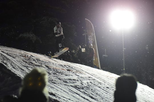 A contestant lands a jump Saturday night at Snow Trails.