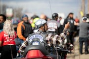 "Kelvin ""Chip"" Malone, a reserve captain with the Shelby County Sheriff's Office, takes pictures of the crowd Sunday, Feb. 9, 2020, before the State of Emergency Ride in Memphis."