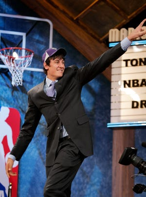 The Milwaukee Bucks selected Andrew Bogut with the first selection in the 2005 NBA draft held at Madison Square Garden in New York City Tuesday June 28, 2005.  Bogut holds up the number one finger as he walks onto the stage the first pick.